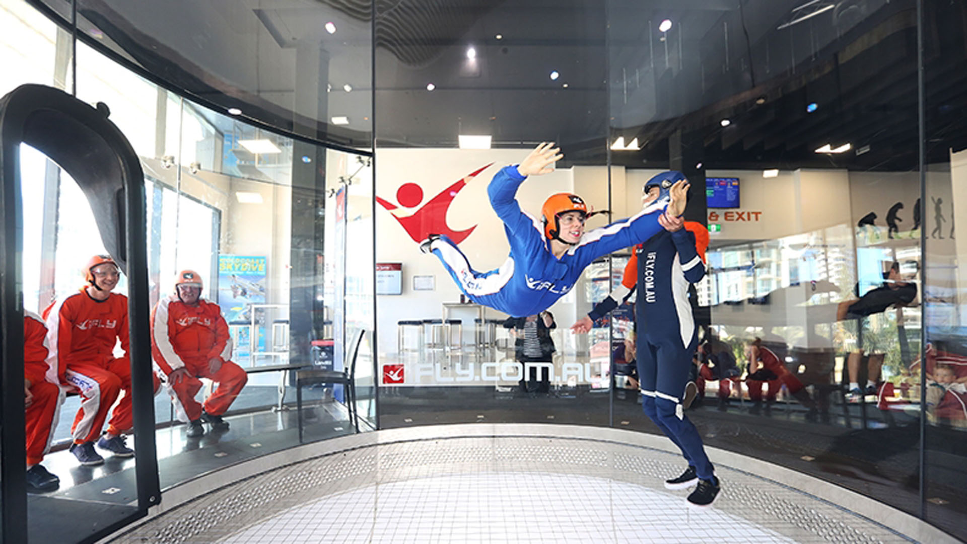 girl wearing orange helmet - indoor skydiving