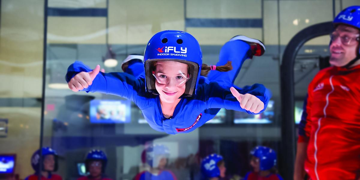 girl with blue suit - indoor skydiving