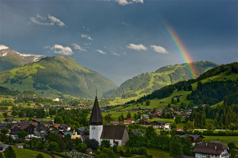 rainbow between mountains - things to do in Switzerland in winter