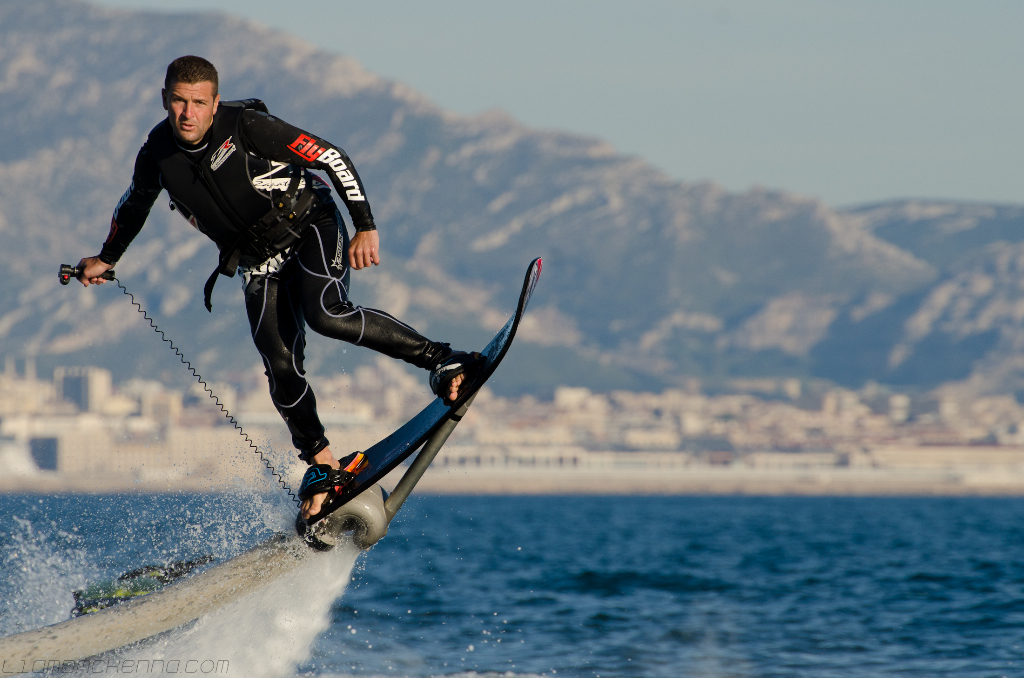 men wearing black suit - flyboarding