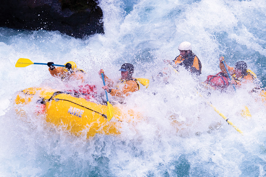 boy with white helmet doing water rafting - white water rafting