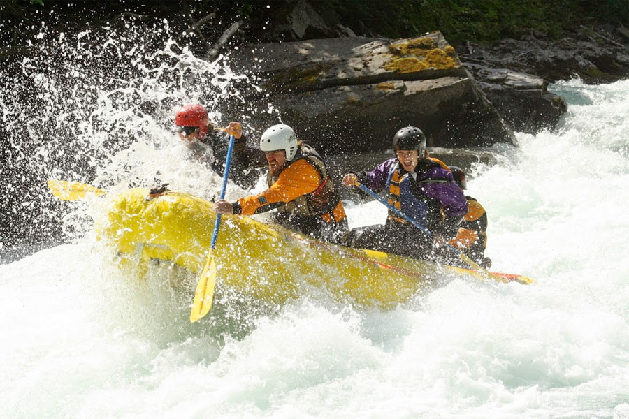boy with purple jacket - white water rafting