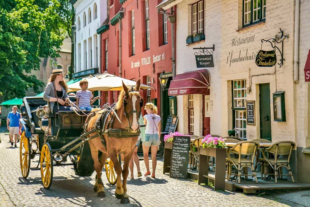 #13 of 15 Things to do in Bruges, Belgium – Have fun riding the horse-drawn Carriage - Things to do in Bruges