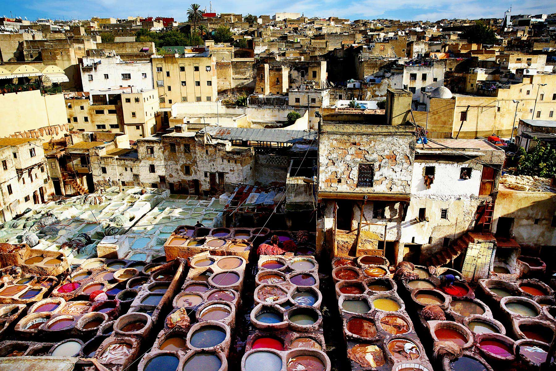 floor filled with paint buckets - things to do in Morocco