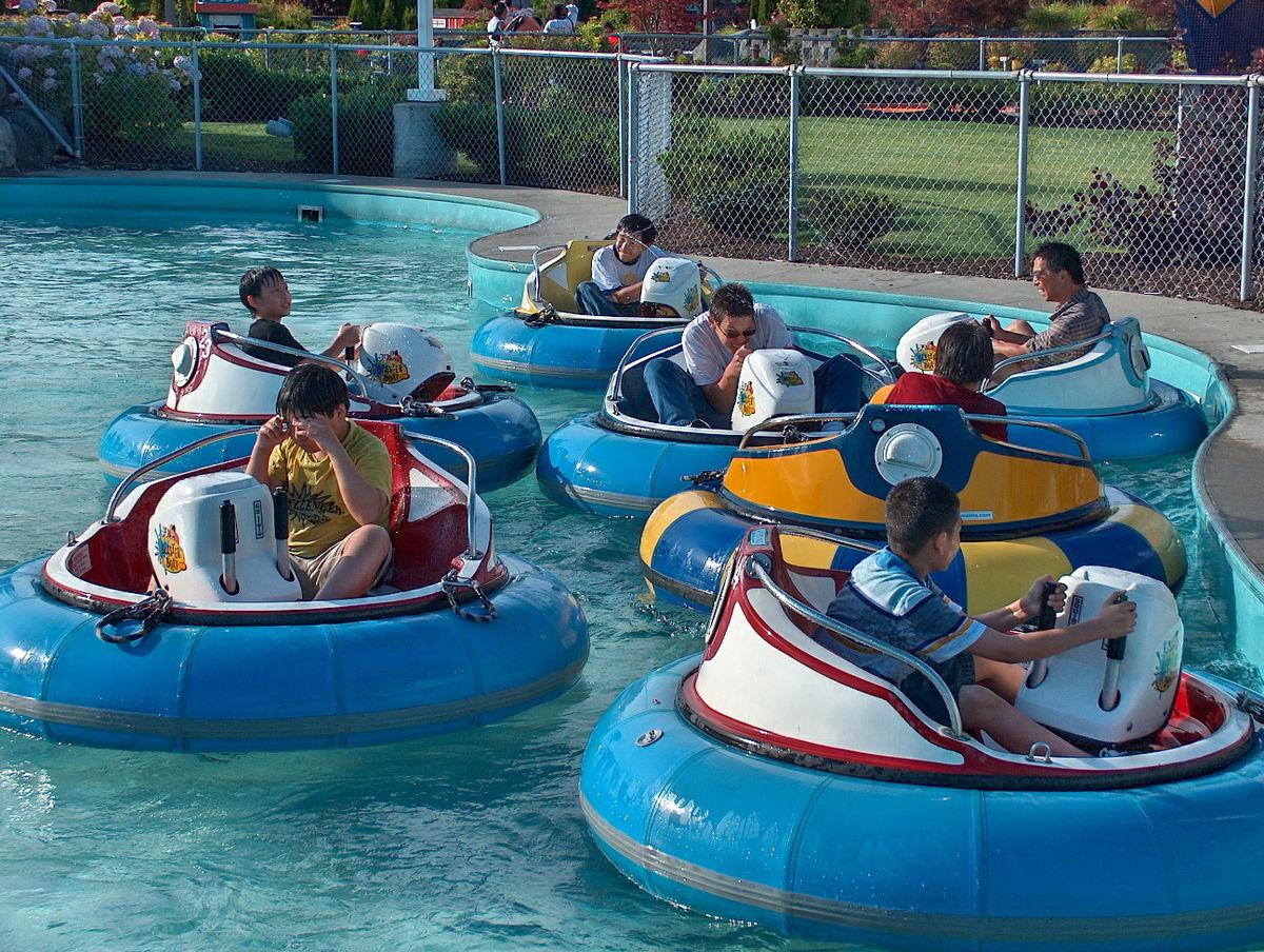 kids riding bumper boats - bumper boats